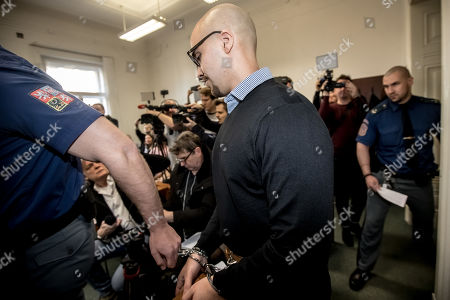 Armin Nahvi is escorted by police for his court proceedings at the Municipal Court in Prague, Czech Republic, April 15, 2019. The prosecutor accused two Dutch, Armin and Arash Nahvi, from a group of seven men, of attempted murder. Seven Dutch men were arrested in Prague for assaulting and waiter in the center of the city on 21 April 2018. As media reported, men were caught on CCTV video attacking a waiter, who told them they could not drink their own alcohol while sitting on the cafe terrace. The assaulted waiter was in intensive care in hospital, where he was treated with brain hemorrhage, broken facial bones and injured eye.