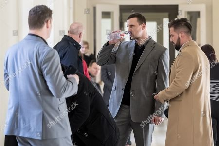 Attacked waiter Miroslav V. (2-R) waits for court proceedings with two Dutch, Armin and Arash Nahvi, at the Municipal Court in Prague, Czech Republic, 15 April 2019. The prosecutor accused two Dutch, Armin and Arash Nahvi, from a group of seven men, of attempted murder. Seven Dutch men were arrested in Prague for assaulting and waiter in the center of the city on 21 April 2018. As media reported, men were caught on CCTV video attacking a waiter, who told them they could not drink their own alcohol while sitting on the cafe terrace. The assaulted waiter was in intensive care in hospital, where he was treated with brain hemorrhage, broken facial bones and injured eye.