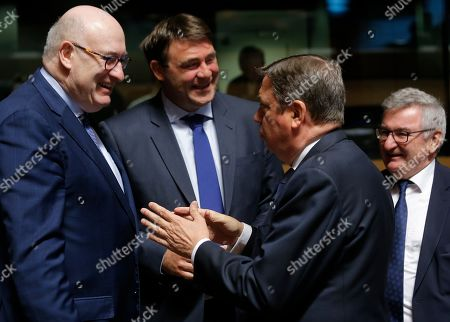 (L-R) European Commissioner for Agriculture and Rural Development Irish Phil Hogan, Belgian Minister SMEs, Entrepreneurs, Agriculture and Social Integration Denis Ducarme, Spanish Agriculture Minister Luis Planas and Walloon Minister of Agriculture, Nature, Rurality, Tourism and Patrimony, Belgian, Rene Collin at the start of the Agriculture and Fisheries Council in Luxembourg, 15 April 2019. Ministers will focus on Post 2020 Common Agricultural Policy (CAP) reform package, Task Force Rural Africa (TFRA) and a discussion on the impact of large carnivores and other species on agriculture.