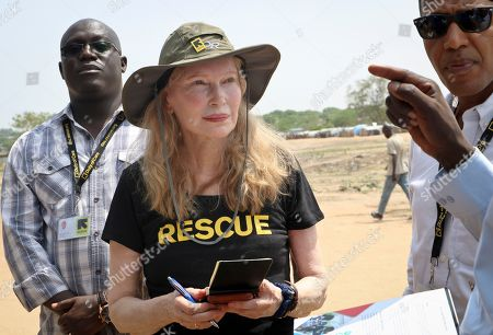 Human rights activist Mia Farrow takes notes while speaking with staff from the International Rescue Committee while visiting an internally displaced person's camp in the capital Juba, South Sudan. Human rights activist Mia Farrow spoke to The Associated Press as she visited South Sudan again in her new role as envoy for the International Rescue Committee, helping the aid group to promote a global initiative to change the way humanitarian organizations approach malnutrition