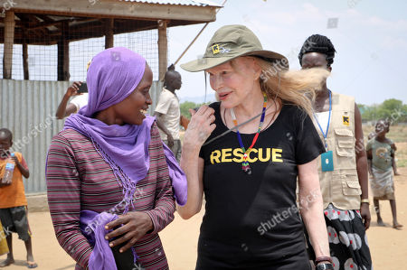 Human rights activist Mia Farrow laughs with staff from the International Rescue Committee while visiting an internally displaced person's camp in the capital Juba, South Sudan. Human rights activist Mia Farrow spoke to The Associated Press as she visited South Sudan again in her new role as envoy for the International Rescue Committee, helping the aid group to promote a global initiative to change the way humanitarian organizations approach malnutrition