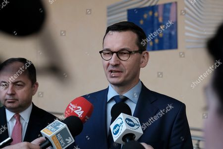 Poland Prime Minister Mateusz Morawiecki (R) and Konrad Szymanski (L), the Polish European affairs minister after signing a ceremony for an agreement on financing the Baltic Pipe Polish-Danish gas pipeline project in Brussels, Belgium, 15 April 2019.