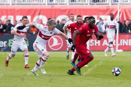 Bastian Schweinsteiger (31) and Jozy Altidore (17) in action
