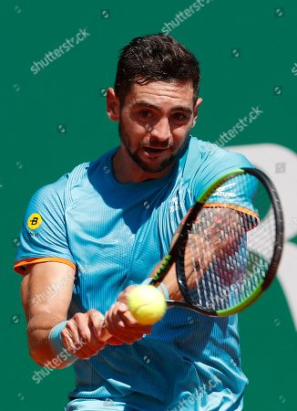 Guido Andreozzi of Argentina in action during his first round match against  David Goffin of Belgium at the Monte-Carlo Rolex Masters tournament in Roquebrune Cap Martin, France, 15 April 2019.