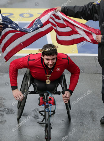 Stock Image of Daniel Romanchuk, of Urbana, Ill., wears the victor's wreath after winning the men's handcycle division of the 123rd Boston Marathon, in Boston