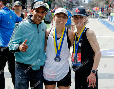 Marathon champions Meb Keflezighi, left, of San Diego, and Joan Benoit Samuelson, right, of Freeport, Maine, pose with her daughter Abby Samuelson, center, of Portland, Ore., after the 123rd Boston Marathon, in Boston