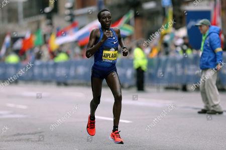 Edna Kiplagat, of Kenya, runs in the 123rd Boston Marathon, in Boston