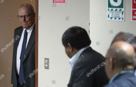 Peru's former President Pedro Pablo Kuczynski returns to a court hearing to determine his release, in Lima, Peru, . A judge in Peru ordered last week the detention for 10 days of the former leader as part of a money laundering probe into his consulting work for the company at the heart of Latin America's biggest graft scandal