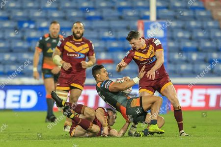 Stock Picture of Peter Mata'utia (1) of Castleford Tigers is tackled by Alex Mellor (12) of Huddersfield Giants