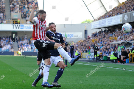 James Meredith of Millwall and Henrik Dalsgaard of Brentford in action during the Sky Bet Championship match between Millwall and Brentford at The Den in London, UK -  19th April 2019