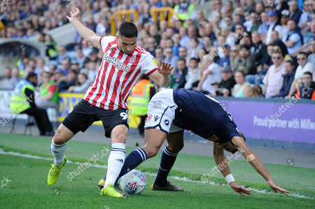 James Meredith of Millwall and Neal Maupay of Brentford in action during the Sky Bet Championship match between Millwall and Brentford at The Den in London, UK -  19th April 2019