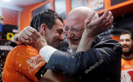 Valencia's President Juan Roig (R) and the team's captain Rafa Martinez (L) celebrate after wining the Eurocup basketball final match against Alba Berlin played at the Fuente de San Luis facilities in Valencia, eastern Spain, 15 April 2019.