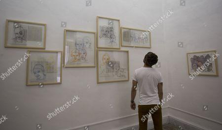 A man looks the work 'Los Hijos de la Patria' by Cuban artist Claribel Calderius in the exhibition 'Ad Infinitum' as part of La Habana Art Biennal at the Arsenal Habana gallery in Havana, Cuba, 13 April 2019 (issued 15 April 2019).