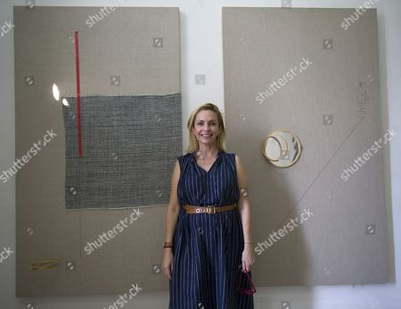 Cuban artist Sandra Perez Lozano poses next to her pieces in the exhibition 'Ad Infinitum' as part of La Habana Art Biennal at the Arsenal Habana gallery in Havana, Cuba, 13 April 2019 (issued 15 April 2019).
