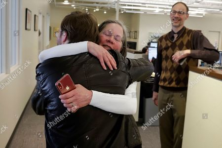 Stock Picture of Pittsburgh Post Gazette City Editor Lillian Thomas, center, hugs reporter Andrew Goldstein in the paper's downtown Pittsburgh newsroom after it was announced that the paper's staff coverage of the shooting at the Tree of Life Synagogue last October was awarded the Pulitzer Prize for Breaking News Reporting