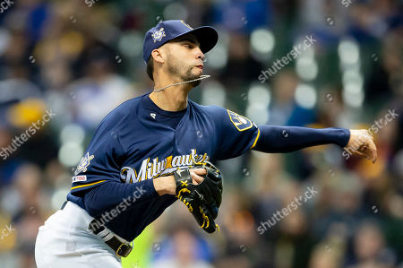 Milwaukee Brewers relief pitcher Alex Claudio #42 delivers res a pitch during the Major League Baseball game between the Milwaukee Brewers and the St. Louis Cardinals at Miller Park in Milwaukee, WI