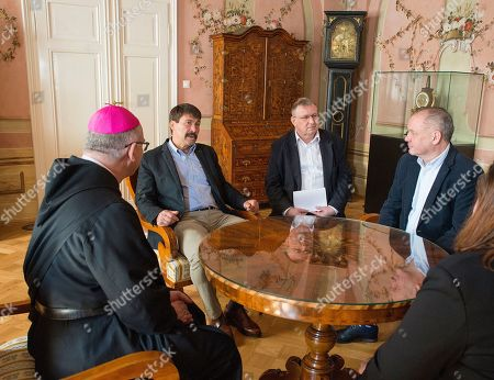 Slovakian President Andrej Kiska (R) and his Hungarian counterpart Janos Ader (2-L) start talks as Archabbot T. Cirill Hortobagyi (L) looks on during their meeting at the Benedictine Archabbey of Pannonhalma, 120 kms west of Budapest, Hungary, 16 April 2019. Kiska pays a farewell visit to Hungary as his mandate expires in next June.