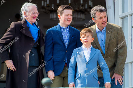 Queen Margrethe II of Denmark with Crown Prince Frederik, Prince Christian and Prince Vincent