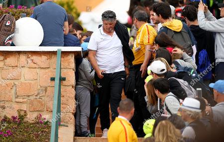 Toni Nadal walks through crowds