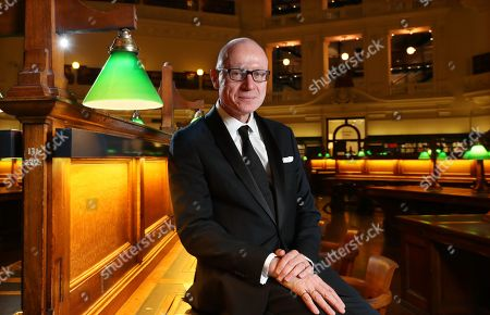 Stock Photo of Chief Executive of News Corporation, Australian journalist Robert Thomson poses for a photograph before delivering the 2019 Keith Murdoch Oration at State Library Victoria in Melbourne, Victoria, Australia, 16 April 2019.