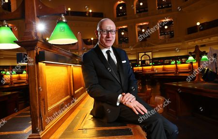 Chief Executive of News Corporation, Australian journalist Robert Thomson poses for a photograph before delivering the 2019 Keith Murdoch Oration at State Library Victoria in Melbourne, Victoria, Australia, 16 April 2019.