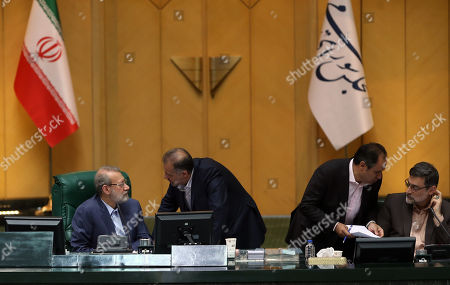 Iranian Parliament speaker Ali Larijani (L) talks to lawmaker during a parliament session in Tehran, Iran, 16 April 2019. According to reports, the Iranian parliament passed a bill labeling US forces in Middle East (Centcom Forces) as terrorist, adding the Islamic Republic of Iran's government is duty-bound to carry out reciprocal and firm measures against American forces' terrorist actions that endanger the Iran's interests. The Iranian bill was passed after the US government decision on 08 April that designated Iran's revolutionary guards corps (IRGC) as a terrorist organization.