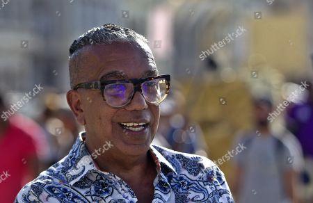 The general curator of the project Detras del Muro (Behind the Wall), Juan Delgado Calzadilla poses in Havana, Cuba, 14 April 2019.