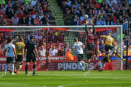 19th April 2019, Bramall Lane, Sheffield, England; Sky Bet Championship, Sheffield United vs Nottingham Forest ;  Dean Henderson (01) of Sheffield United saves from Yohan Benalouane (29) of Nottingham Forest Credit: Craig Milner/News Images English Football League images are subject to DataCo Licence