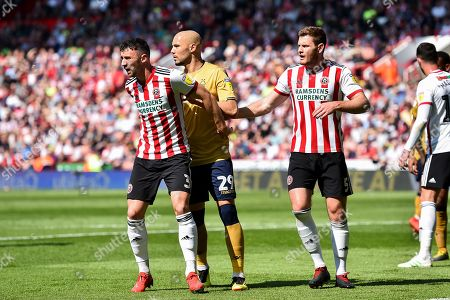 19th April 2019, Bramall Lane, Sheffield, England; Sky Bet Championship, Sheffield United vs Nottingham Forest ; Enda Stevens (3) of Sheffield United and Jack O'Connell (5) of Sheffield United mark Yohan Benalouane (29) of Nottingham Forest during a Forest throw-in Credit: Jon Hobley/News Images English Football League images are subject to DataCo Licence