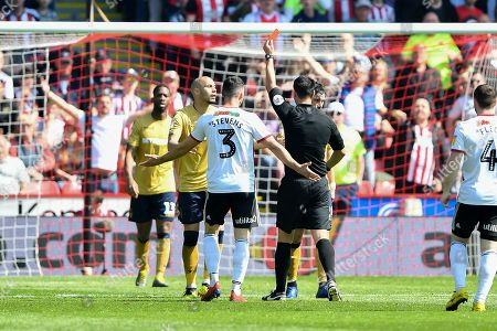 19th April 2019, Bramall Lane, Sheffield, England; Sky Bet Championship, Sheffield United vs Nottingham Forest ; Referee Andrew Madley shows a red card and sends off Yohan Benalouane (29) of Nottingham Forest  Credit: Jon Hobley/News Images English Football League images are subject to DataCo Licence