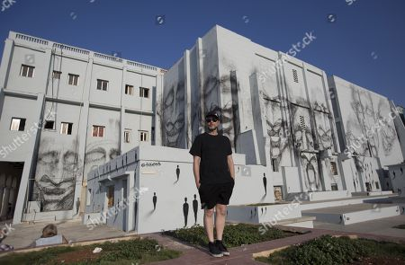 Spanish artist Suso33 posing with his graffiti work part of the project Detrás del Muro (Behind the Wall), in Havana, Cuba, 14 April 2019 (issued 16 April 2019). The 13th Havana Biennial runs from 12 April until 12 May.