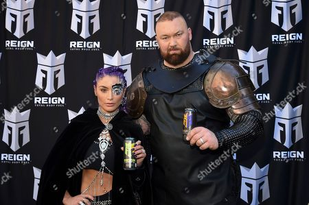 Natalie Eva Marie, Hafthor Bjornsson. Former WWE wrestler Natalie Eva Marie, left, and actor Hafthor Bjornsson participate in the launch of Monster Energy's Reign Total Body Fuel at Greeley Square Park, in New York