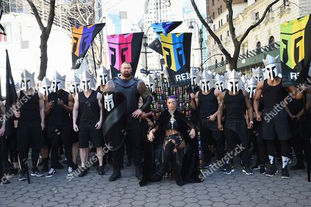 Hafthor Bjornsson, Natalie Eva Marie. Actor Hafthor Bjornsson center left, and former WWE wrestler Natalie Eva Marie, seated, participate in the launch of Monster Energy's Reign Total Body Fuel at Greeley Square Park, in New York