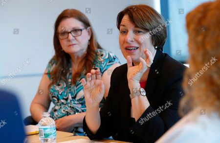 Amy Klobuchar, Andrew Gillum. Democratic presidential candidate Amy Klobuchar, center, speaks during a roundtable discussion on health care, in Miami. Klobuchar met with local medical professionals and advocates to talk about the cost of prescription drugs access to healthcare