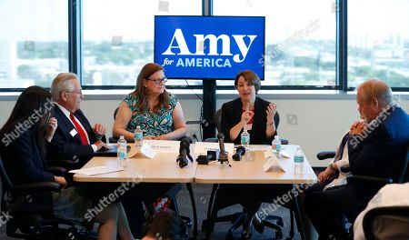 Amy Klobuchar, Andrew Gillum. Democratic presidential candidate Amy Klobuchar, center right, speaks during a roundtable discussion on health care, in Miami. Klobuchar met with local medical professionals and advocates to talk about the cost of prescription drugs access to healthcare