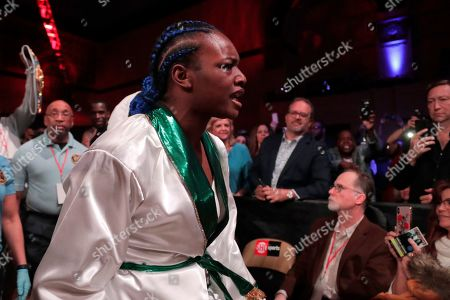 Claressa Shields enters the arena prior to fighting Christina Hammer during the women's unification world middleweight championship boxing bout, in Atlantic City, N.J