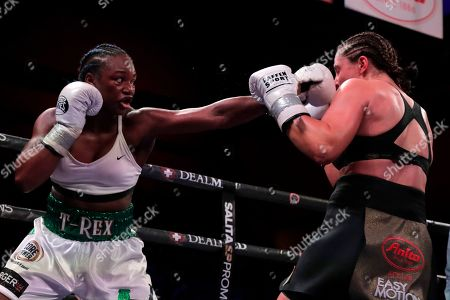 Claressa Shields, left, fights Christina Hammer during the seventh round of a women's unification world middleweight championship bout, in Atlantic City, N.J
