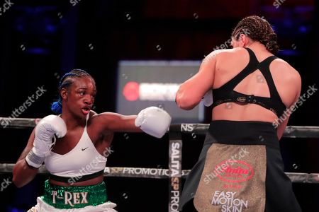 Claressa Shields, left, fights Christina Hammer during the first round of a women's unification world middleweight championship bout, in Atlantic City, N.J