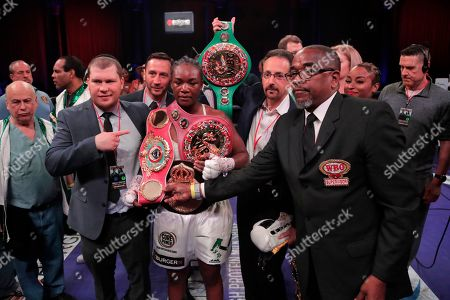 Claressa Shields holds her belts after defeating Christina Hammer during the women's unification world middleweight championship boxing bout, in Atlantic City, N.J. Shields won by unanimous decision