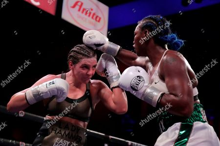 Claressa Shields, right, fights Christina Hammer during the ninth round of a women's unification world middleweight championship bout, in Atlantic City, N.J