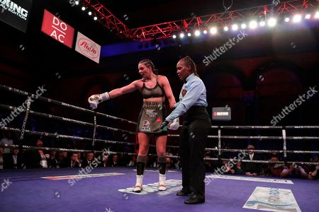 Christina Hammer, left, points to her mouthpiece while talking to referee Sparkle Lee during the eighth round of a women's unification world middleweight championship boxing bout against Claressa Shields, in Atlantic City, N.J. Shields won by unanimous decision