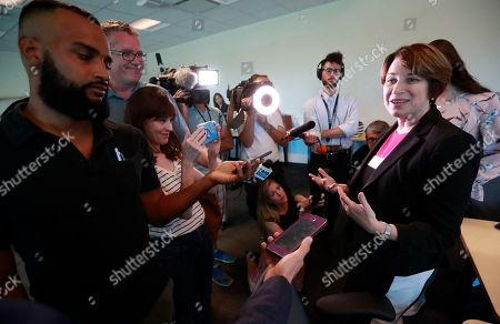 Andrew Gillum. Democratic presidential candidate Amy Klobuchar, right, speaks to members of the media after a roundtable discussion on health care, in Miami. Klobuchar met with local medical professionals and advocates to talk about the cost of prescription drugs access to healthcare