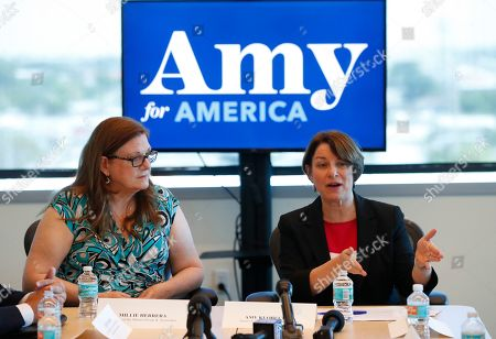 Andrew Gillum. Democratic presidential candidate Amy Klobuchar, right, speaks as Millie Herrera, founder of the Miami Group & Associates, looks on during a roundtable discussion on health care, in Miami. Klobuchar met with local medical professionals and advocates to talk about the cost of prescription drugs access to healthcare