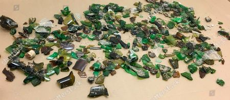 "Provided by the Sleeping Bear Dunes National Lakeshore in Glen Haven, Mich., shows broken glass collected by officials along the national lakeshore that have been strewn along the Lake Michigan beach. District Ranger Andy Blake said Tuesday it appears thousands of pieces were spread deliberately near the Good Harbor Picnic Area at the east end of Lake Michigan Road in Leelanau County's Cleveland Township. Blake says the glass wasn't dumped in one spot but was spread ""fairly uniformly up and down the beach for several hundred yards."" Park Superintendent Scott Tucker says the ""mean-spirited crime"" was ""clearly intended"" to injure beachgoers. A similar incident happened along another area beach in October 2017. Officials are appealing to the public for information"