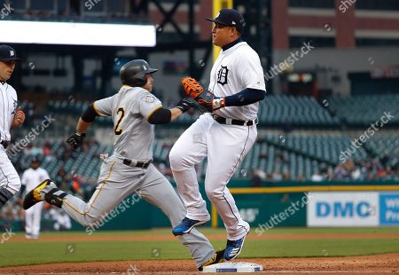Detroit Tigers first baseman Miguel Cabrera beats Pittsburgh Pirates' JB Shuck, left, to first base in the fourth inning of a baseball game in Detroit