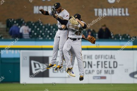 Pittsburgh Pirates' Starling Marte, left, celebrates with JB Shuck after defeating the Detroit Tigers 5-3 in 10 innings of a baseball game in Detroit