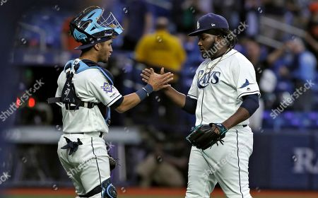 Michael Perez, Diego Castillo. Tampa Bay Rays relief pitcher Diego Castillo, right, celebrates with catcher Michael Perez after closing out the Baltimore Orioles during the ninth inning of a baseball game, in St. Petersburg, Fla