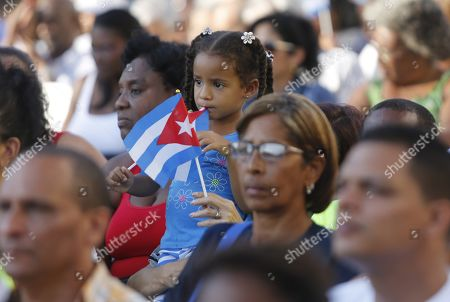 People attend an event to commemorate the 58th anniversary of the declaration of the socialist character of the Cuban Revolution by Fidel Castro, in Havana, Cuba, 16 April 2019.