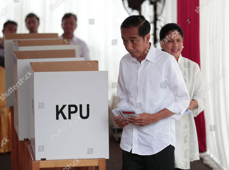 "Joko Widodo. Indonesian President Joko ""Jokowi"" Widodo and his wife Iriana walk with their ballots during the election at a polling station in Jakarta, Indonesia, . Tens of millions of Indonesians were voting in presidential and legislative elections Wednesday after a campaign that pitted the moderate incumbent against an ultranationalist former general whose fear-based rhetoric warned the country would fall apart without his strongman leadership"