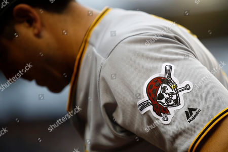 A Pittsburgh Pirates patch is seen on JB Shuck's jersey as he prepares for an at-bat during a baseball game against the Washington Nationals, in Washington